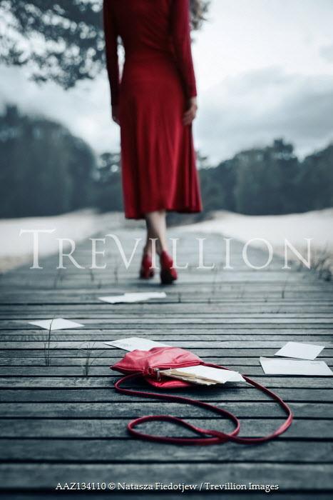 Natasza Fiedotjew red handbag full of letters dropped on boardwalk by woman walking away