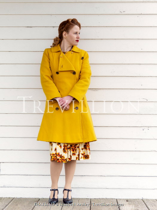 Elisabeth Ansley WOMAN WITH RED HAIR IN COAT OUTDOORS