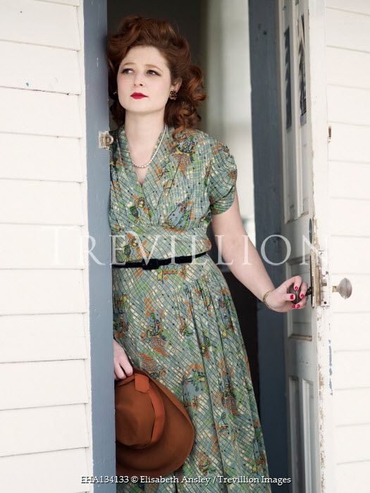 Elisabeth Ansley 1940S WOMAN WITH RED HAIR OPENING DOOR