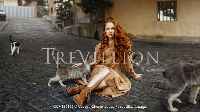 Georgy Chernyadyev WOMAN WITH RED HAIR SITTING IN STREET WITH CTAS