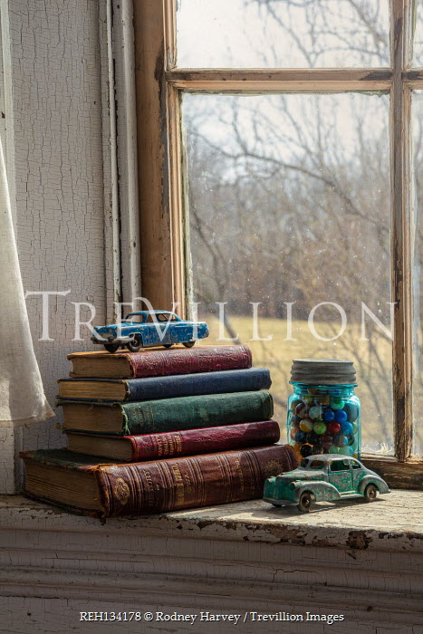 Rodney Harvey BOOKS TOY CARS AND MARBLES INDOORS BY WINDOW
