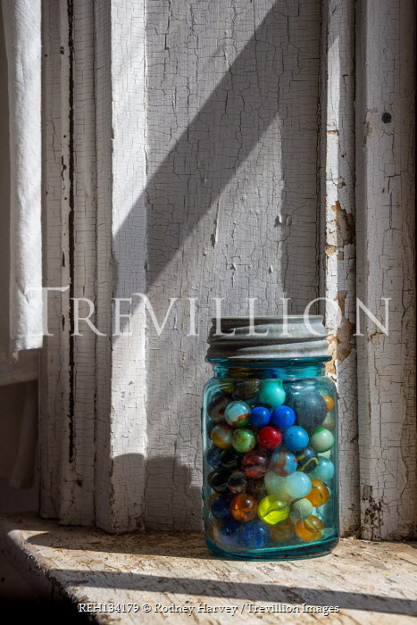 Rodney Harvey JAR OF MARBLES INDOORS BY WINDOW