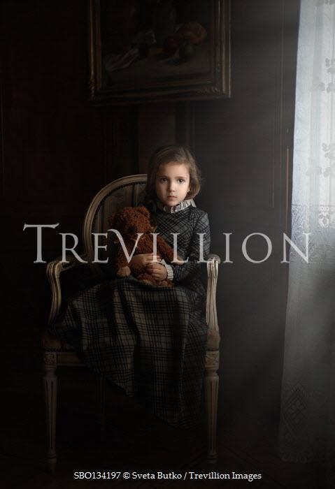 Sveta Butko LITTLE GIRL WITH TEDDY SITTING IN HOUSE