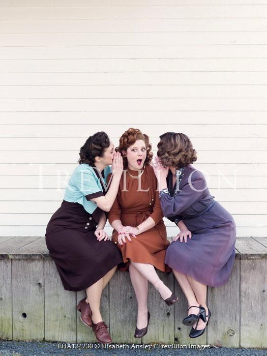 Elisabeth Ansley GROUP OF RETRO WOMEN WHISPERING ON VERANDA