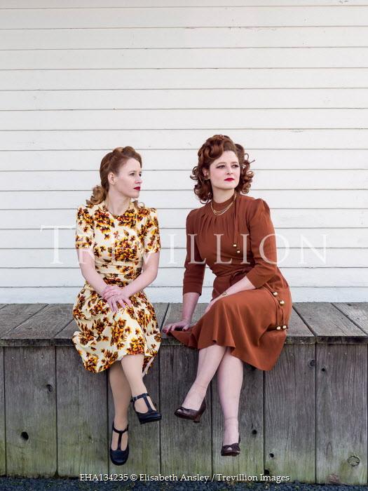 Elisabeth Ansley TWO RETRO WOMEN SITTING ON VERANDA