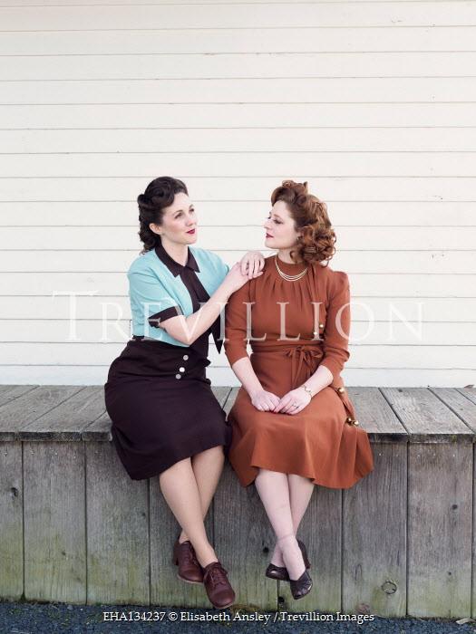 Elisabeth Ansley TWO HAPPY RETRO WOMEN SITTING ON VERANDA