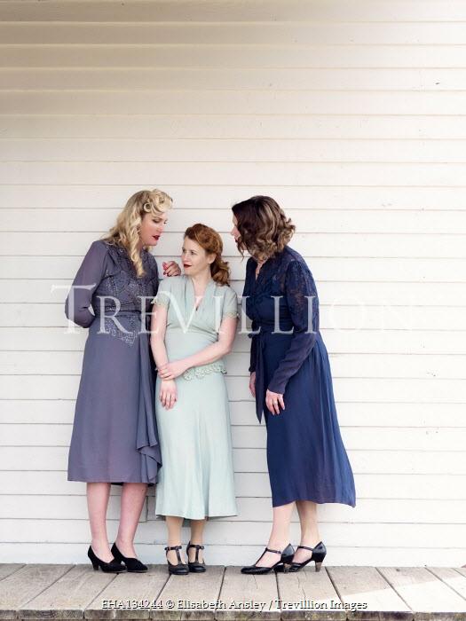 Elisabeth Ansley THREE RETRO WOMEN TALKING ON VERANDA