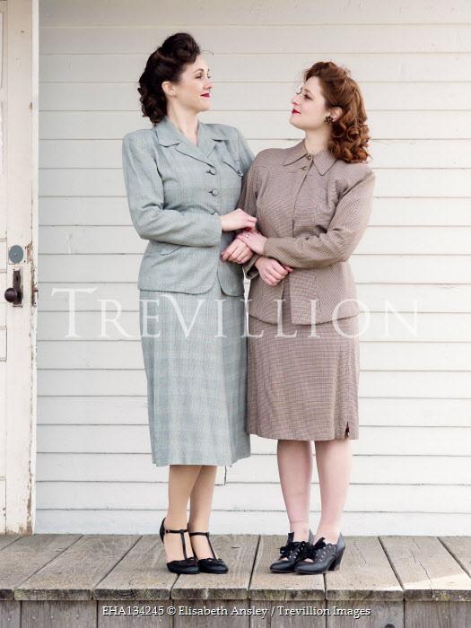 Elisabeth Ansley TWO RETRO WOMEN ARM IN ARM ON VERANDA