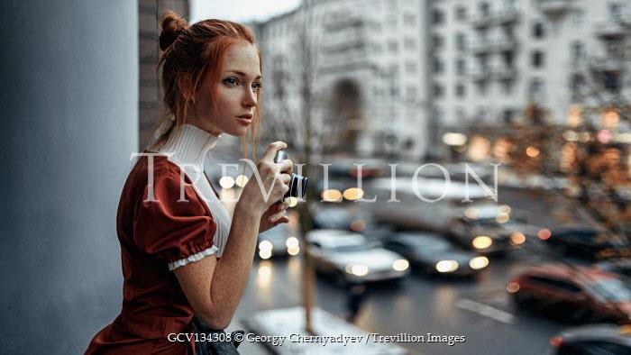 Georgy Chernyadyev GIRL WITH CAMERA WATCHING TRAFFIC IN CITY