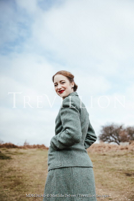 Matilda Delves SMILING RETRO WOMAN IN COUNTRYSIDE