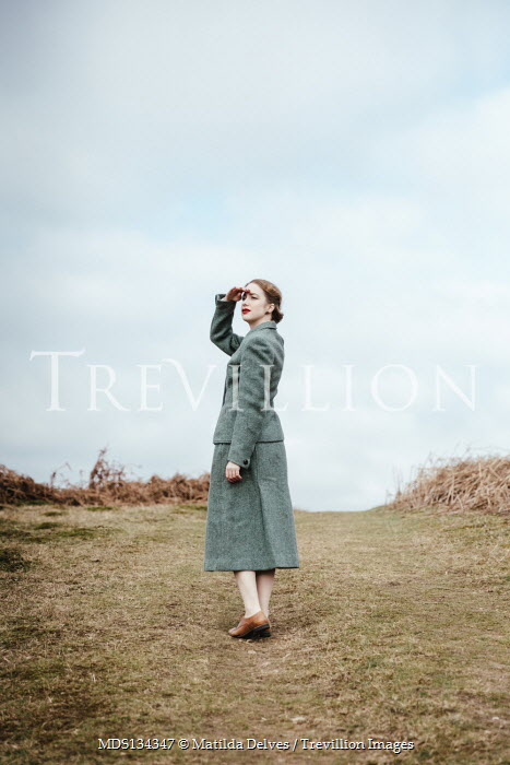 Matilda Delves RETRO WOMAN SEARCHING IN COUNTRYSIDE
