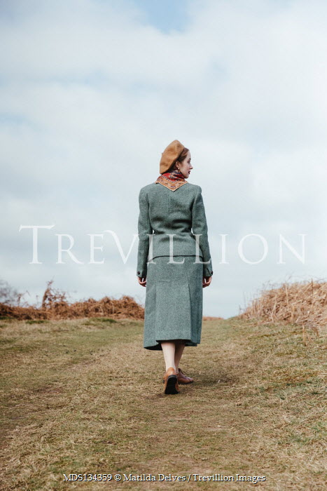 Matilda Delves 1940S WOMAN WALKING IN IN COUNTRYSIDE