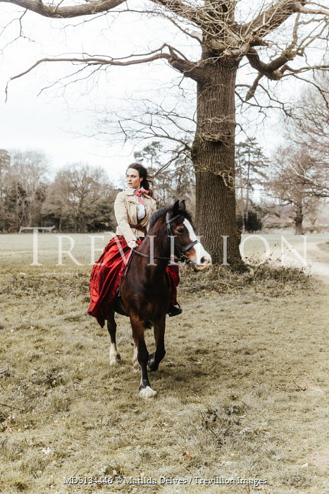 Matilda Delves HISTORICAL WOMAN RIDING HORSE IN COUNTRYSIDE