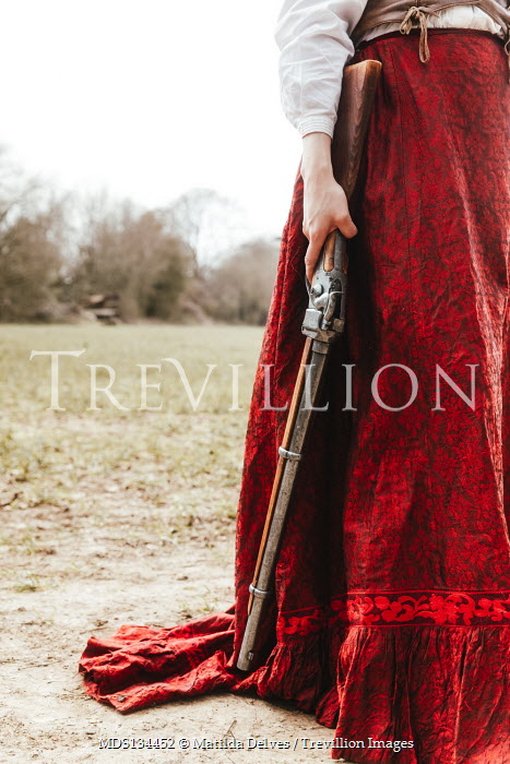 Matilda Delves HISTORICAL WOMAN HOLDING RIFLE IN COUNTRYSIDE