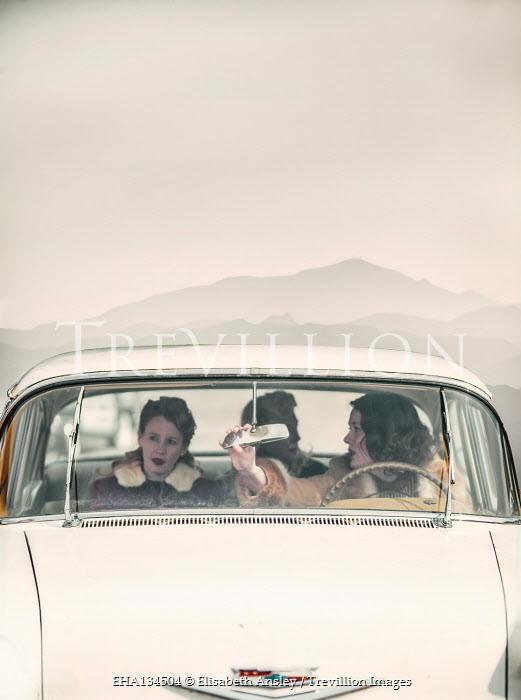Elisabeth Ansley THREE RETRO WOMEN TRAVELLING IN CAR
