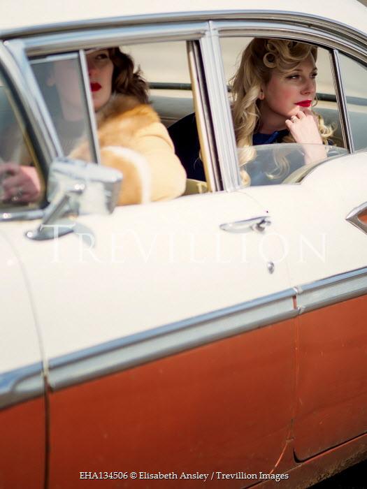 Elisabeth Ansley TWO RETRO WOMEN SITTING IN CAR