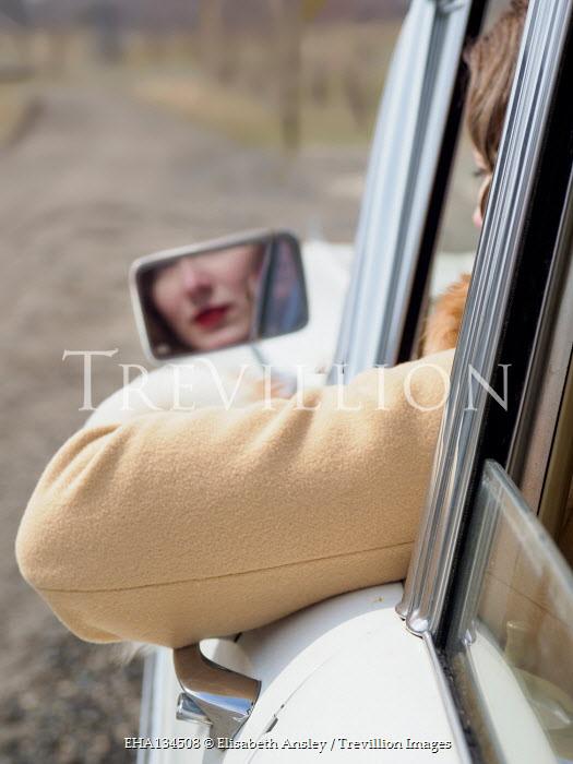 Elisabeth Ansley RETRO WOMAN REFLECTED IN CAR MIRROR