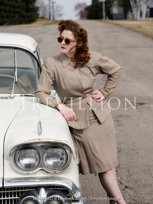Elisabeth Ansley RETRO WOMAN LEANING AGAINST CAR WITH SUNGLASSES