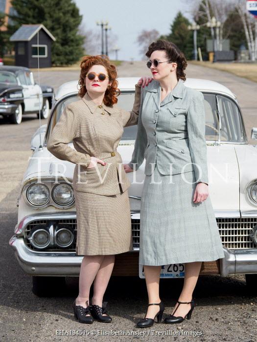 Elisabeth Ansley TWO AMERICAN RETRO WOMEN STANDING BY CAR