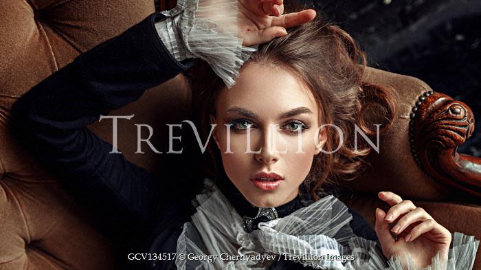 Georgy Chernyadyev HISTORICAL BRUNETTE WOMAN LYING ON SETTEE
