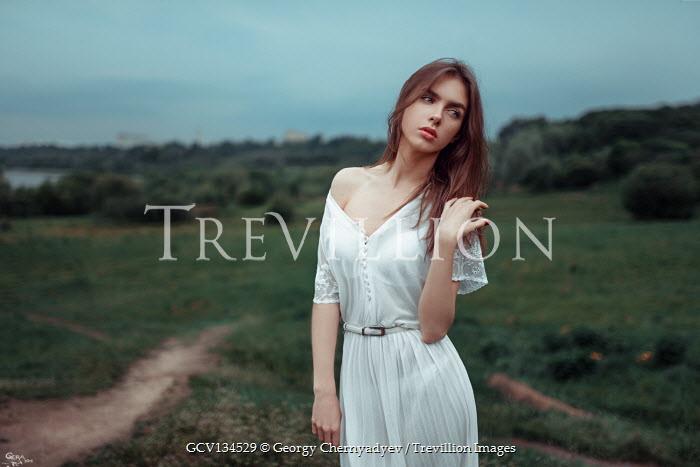 Georgy Chernyadyev BRUNETTE WOMAN IN WHITE DRESS IN COUNTRYSIDE