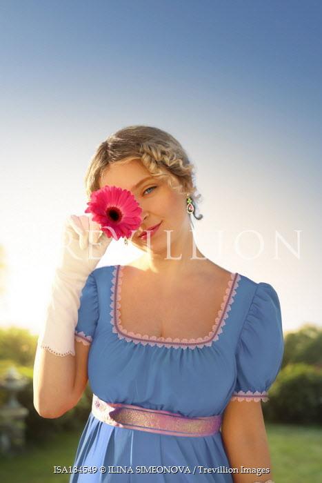 ILINA SIMEONOVA HISTORICAL WOMAN HOLDING FLOWER IN SUMMERY GARDEN