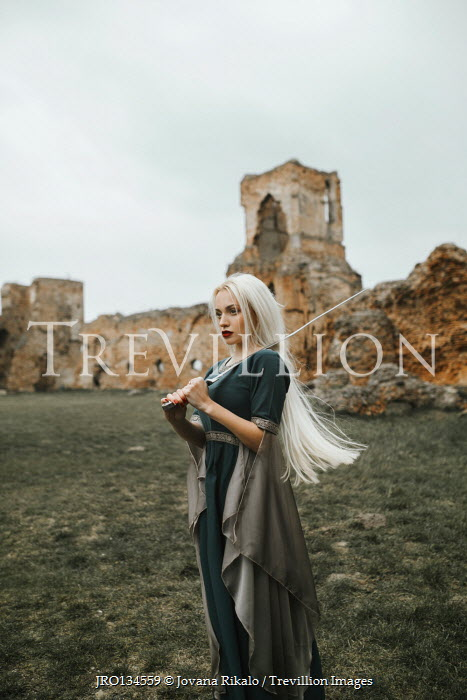 Jovana Rikalo MEDIEVAL WOMAN WITH SWORD BY RUINED BUILDING