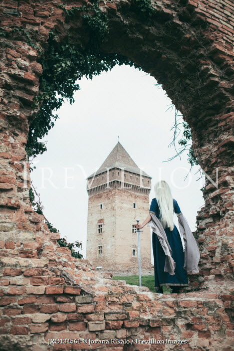 Jovana Rikalo MEDIEVAL WOMAN WITH SWORD BY WALL WATCHING TOWER