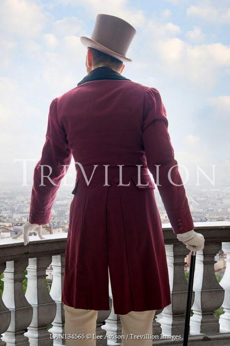 Lee Avison regency man leaning on a balustrade seen from behind