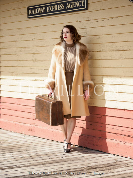 Elisabeth Ansley Young woman in fur coat at train station