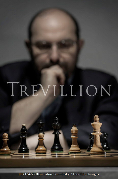 Jaroslaw Blaminsky Thinking man at chess board