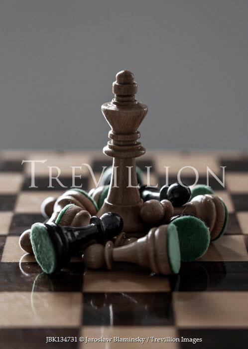 Jaroslaw Blaminsky King and fallen chess pieces on board