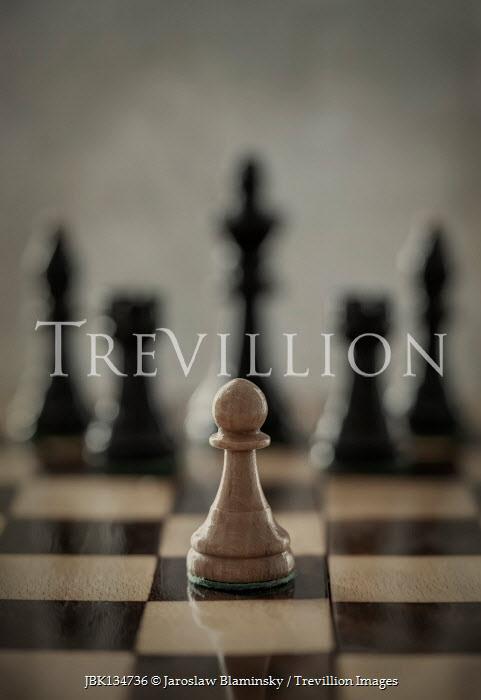 Jaroslaw Blaminsky Pawn on chess board