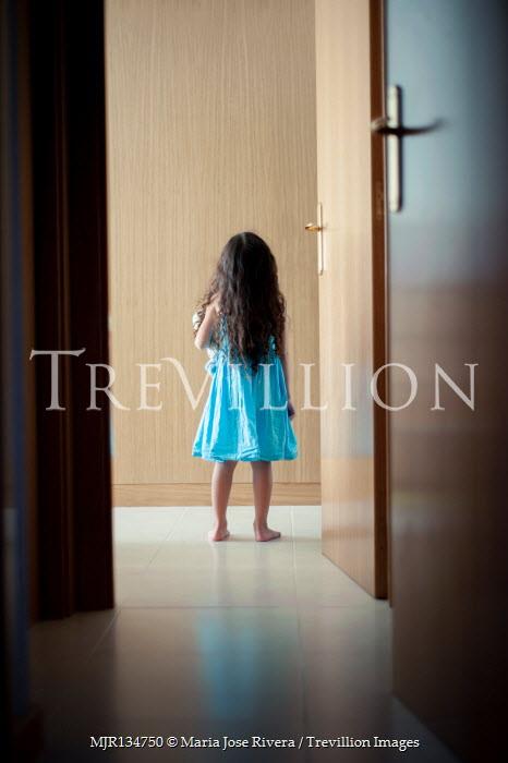 Maria Jose Rivera Girl in blue dress standing in doorway