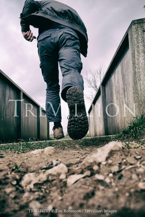 Tim Robinson Man running in alley