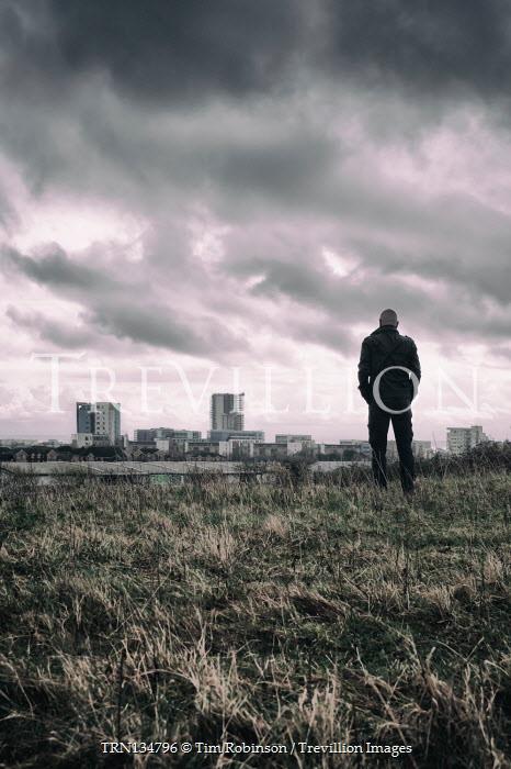 Tim Robinson Man standing in field by city