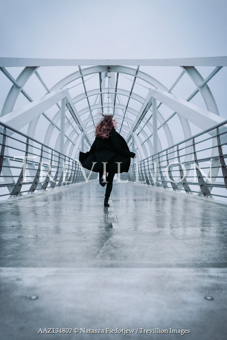 Natasza Fiedotjew woman in black running on bridge