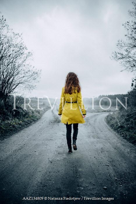 Natasza Fiedotjew woman in yellow coat on crossroads
