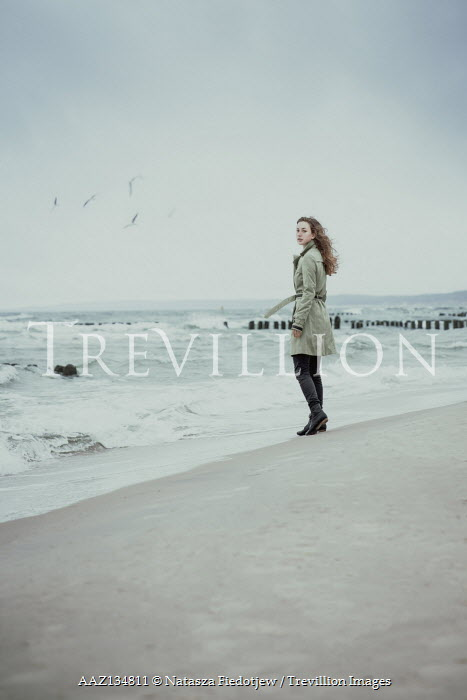 Natasza Fiedotjew teenage girl standing on beach in rain