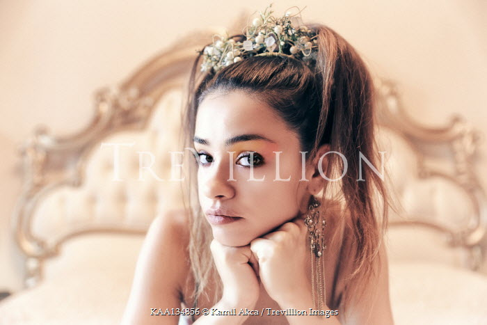 Kamil Akca Young woman sitting on bed