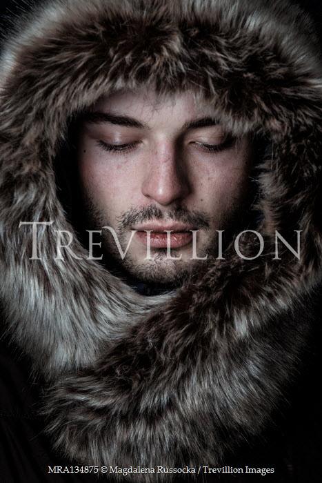 Magdalena Russocka close up of young man in fur hood