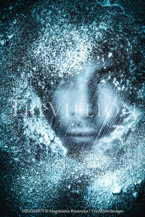 Magdalena Russocka close up of young man behind snowy glass