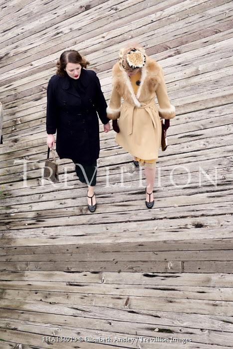Elisabeth Ansley TWO RETRO WOMEN WALKING ON PIER