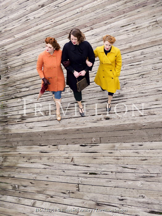 Elisabeth Ansley THREE RETRO WOMEN WALKING ON PIER