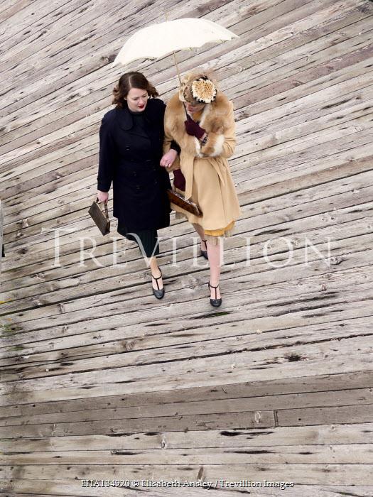 Elisabeth Ansley TWO WOMEN WALKING ON PIER WITH UMBRELLA