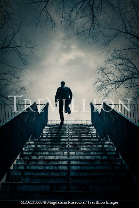 Magdalena Russocka modern man running up urban steps