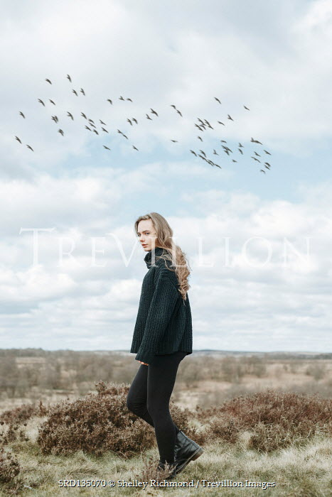 Shelley Richmond GIRL IN BOOTS AND SWEATER WALKING IN COUNTRYSIDE
