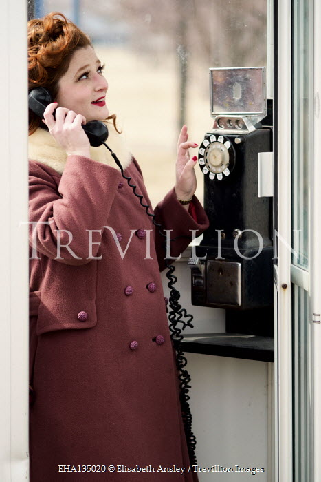 Elisabeth Ansley RETRO WOMAN WITH RED HAIR IN TELEPHONE BOX