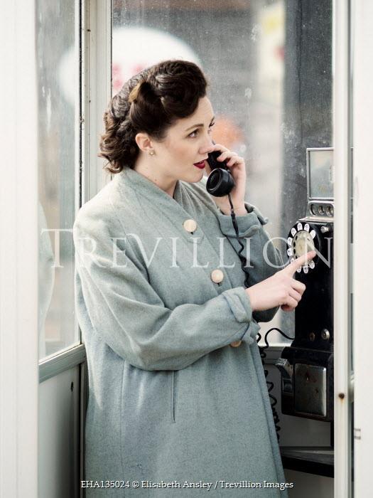 Elisabeth Ansley RETRO WOMAN TALKING IN TELEPHONE BOX