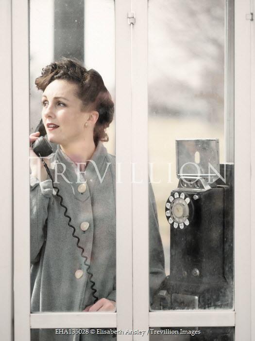 Elisabeth Ansley SERIOUS RETRO WOMAN IN TELEPHONE BOX